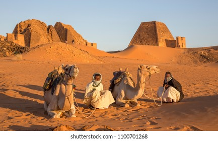 Meroe Pyramids, Sudan- 19th December, 2015: sudanese men with their camels in a desert of Sudan