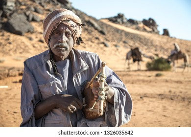 Meroe, Sudan, 19th Decemver, 2015: sudanese man playing traditional musical instrument called kissar