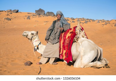 Meroe, Sudan, 19th Decemver, 2015: happy sudanese boy with his camel in a desert