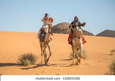 Meroe, Sudan, 19th Decemver, 2015: happy sudanese boys on their camels in a desert