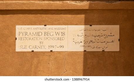Meroe, Sudan, February 11., 2019: Inscription on a plaque on a pyramid restored by Sue Carney