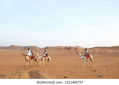 Meroe/Sudan - January 7, 2019: Pyramids of old sudanis pharaons and loca bedouins ring camels.