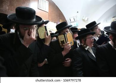 "MERON, ISRAEL - APR 9, 2018: Men belonging to the Jewish hasidic sect called ""Prushim,"" pray at the gravesite of Rabbi Shimon Bar Yochai in Meron, Israel"
