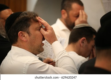 Meron ,Israel - April 26, 2017: Ultra orthodox Jews pray at gravesites of Rabbi Shimon bar Yohai , in the Northern Israeli city of Meron, ahead of the Jewish holiday of Lag Baomer.