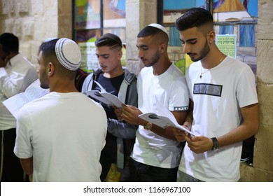 MERON, ISRAEL - AUG 26, 2018: Unidentified young Jewish teenage boys recite the forgiveness prayer at the grave of Rabbi Shimon Bar Yochai in Meron, Israel prior to the holiday of Rosh Hashana