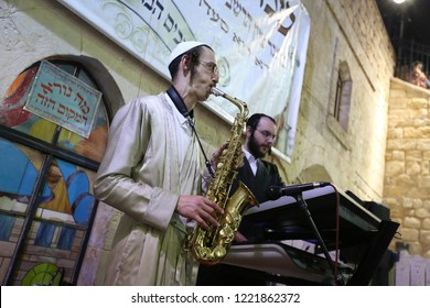 MERON, ISRAEL -AUG 4, 2018: Two unidentified Jewish youth play a saxophone and keyboard at a free open event in the courtyard of the grave of Rabbi Shimon Bar Yochai in Meron, Israel