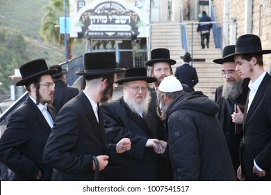 MERON, ISRAEL - Dec. 20, 2017: The Sasov Rebbe arrives in Meron, Israel to pray at the holy site and blesses and shakes hands of fellow Jews