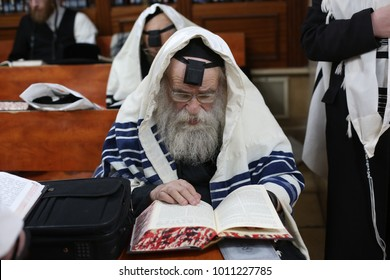 MERON, ISRAEL - Dec 27, 2017: Gaavad (Gaon Av Beis Din)/Admor Makov/Makover Rebbe dons Tefillin and Talit, prays in Meron the Shacharit prayer which Jews pray every morning