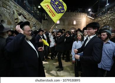 MERON, ISRAEL - FEB 21, 2018: Rabbi Ahrale Kirshenbaum dances with a friend during the memorial celebration in honor of Moses in Meron, Israel