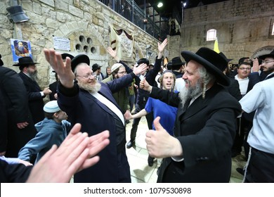 MERON, ISRAEL - FEB 21, 2018: Rabbi Ahrale Kirshenbaum dances with a friend during the memorial celebration in honor of Moses in Meron, Israel