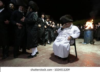 MERON, ISRAEL - FEB 3, 2018: Grand hasidic Rabbi Yechezkel Roth in Meron, Israel, lighting the traditional bonfire in honor of Rabbi Shimon bar Yochai