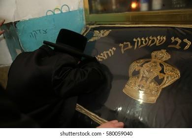 Meron ,Israel, January 15, 2017-  the Rabbi from of the Nadvorna dynasty  pray at the tomb of Rabbi Shimon Bar Yochai in Meron.
