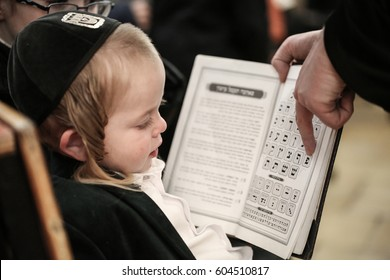 Meron ,Israel, March 5 2017-  a Orthodox Jews father teaches his toddler / little son the hebrew alphabet.