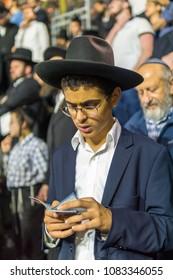 MERON, ISRAEL - MAY 03, 2018: Orthodox Jewish men take part in the annual hillula of Rabbi Shimon Bar Yochai, in Meron, Israel, on Lag BaOmer Holiday