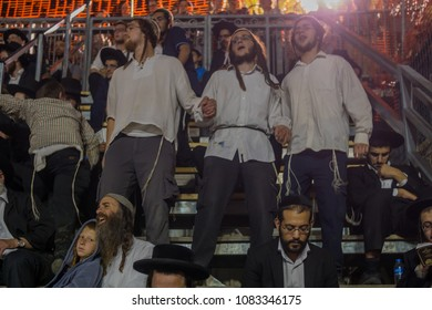 MERON, ISRAEL - MAY 03, 2018: Orthodox Jewish men attend and dance, at the annual hillula of Rabbi Shimon Bar Yochai, in Meron, Israel, on Lag BaOmer Holiday