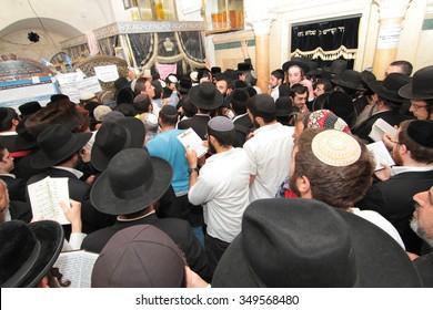 MERON, ISRAEL - MAY 07, 2015: Orthodox Jews pray at the annual hillulah of Rabbi Shimon Bar Yochai, in Meron, Israel, on Lag BaOmer Holiday. This is an annual celebration at the tomb of Rabbi Shimon