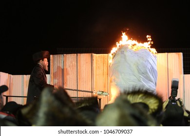 "MERON, ISRAEL - MAY 14, 2017: Jewish Grand Rabbi of Boyan hasidic sect prays and lights bonfire at the grave of Rabbi Shimon bar Yochai on the Jewish holiday of ""Lag Baomer"" in Meron, Israel"