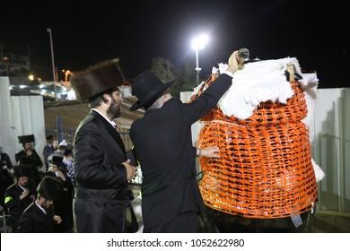 MERON, ISRAEL - MAY 14, 2017:  Unidentified hasidic Jewish men prepare bonfire to be lit in honor of Rabbi Shimon bar Yochai in Meron, Israel on the Jewish holiday of Lag Baomer