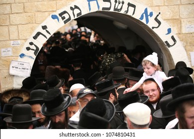 MERON, ISRAEL - MAY 14, 2017: Unidentified group of Jewish men from all sects dance at the entrace to the gravesite of Rabbi Shimon Bar Yochai on the Jewish holiday of Lag Baomer in Meron, Israel