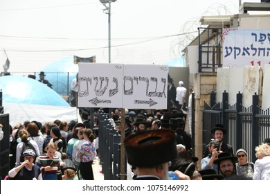 MERON, ISRAEL - MAY 14, 2017: Signs directing to the separate paths for men and women to go up to the grave of Rabbi Shimon Bar Yochai in Meron, Israel on the Jewish holiday of Lag Baomer