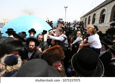 MERON, ISRAEL - MAY 14, 2017: Large group of unidentified Jewish men pray morning services on the roof of the tomb of Rabbi Shimon Bar Yochai in Meron, Israel on the Jewish holliday of Lag Baomer