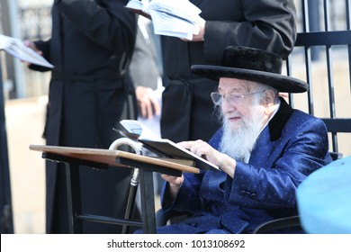 MERON, ISRAEL - MAY 17, 2017: The elder of the Admorim/Grand Hasidic Rabbis, The Spinka Rebbe, prays and learns Torah in Meron where he also lights a bonfire in honor of Rabbi Shimon Bar Yochai