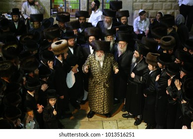 MERON, ISRAEL - May 17, 2017: The Admor of Vitznitz (Grand Rabbi of Viznitz hasidim) with his followers, dance and sing in the courtyard of the tomb of Rabbi Shimon bar Yochai