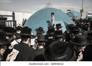 MERON, ISRAEL - MAY 26, 2016: Orthodox Jews celebrates Lag Ba'omer in Bar Yochai tomb in Meron , Israel on May 10 2012 , Lag Ba'omer is a Jewish holiday in wich it is customary to light bonfire