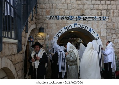 MERON, ISRAEL - OCT 11, 2017: Ultra orthodox Jewish men wrapped in Tallit (prayer shawl) pray on the holiday of Sukkot in Meron, Israel