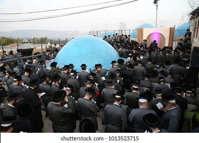 MERON, ISRAEL - Sep 14, 2017: Toldos Aharon Hasidim (hasidic Jews) gather and pray in a large group with their Rabbi (Admor Toldos Aharon) on the roof of the tomb of Rabbi Shimon bar Yochai in Meron