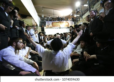 MERON, ISRAEL-MAY 14, 2018:Unidentifid Jewish man does flips and dances wildly during Jewish holiday of Lag Baomer in Meron, Israel celebrating the memorial of Rabbi Shimon Bar Yochai