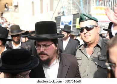 MERON,ISRAEL- MAY 26, 2016: An Israeli policeman dancing wish Orthodox Hasidic group,  during the Lag Ba'omer festivities honoring Rabbi Shimon Bar Yochai