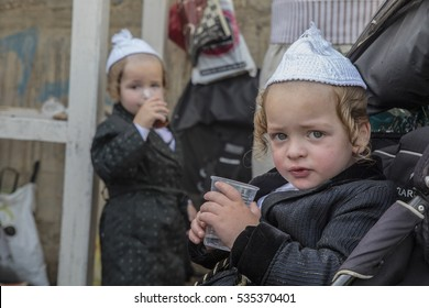 "MERON,ISRAEL- MAY 26, 2016: Two special Hasidic children celebrates Lag Ba'omer in Bar Yochai tomb . Orthodox Jews, singing and dancing annual Hillula the annual ""hilula"" celebration in meron 2016"