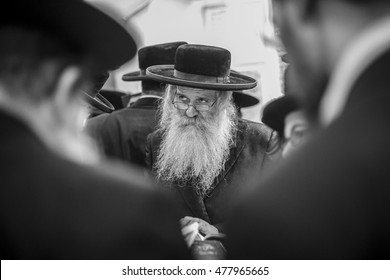 MERON,ISRAEL- September 2, 2016:  Orthodox Jews pray at the tomb of Rabbi Shimon Bar Yochai in Meron. Special character of the Jewish rabbi, with a white beard and black hat