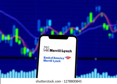 Merrill Lynch logo is seen on an smartphone over stock chart