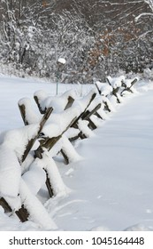 Merrimack, N.H., USA, March 8, 2018. Snow on an old wooden fence after a New England storm.