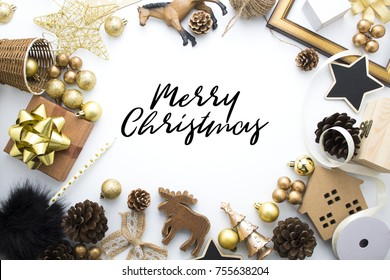 merry chrismas vintage season greeting holiday gold tone color luxury decoration on white background in top view, golden ball, gift box, pen, party, star, horse, toy, deer, wood, home, pine cone, love
