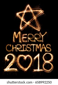 Merry Christmas 2018 word written with Sparkle firework on black background