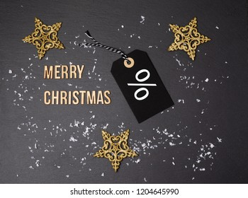 Merry Christmas background and price label.  Black Friday. Sales concept. Copy space.  Black paper label against a dark grey background. Black Friday shopping sale concept with ticket Sale. Per cent.