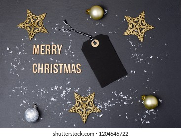 Merry Christmas background and price label.  Black Friday. Sales concept. Copy space.  Black paper label against a dark grey background. Black Friday shopping sale concept with ticket Sale tag