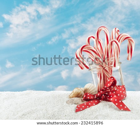 merry christmas at the beach with candy canes in a jar in the sand and sky - Merry Christmas Beach Images