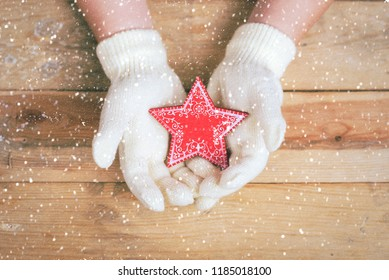 Merry Christmas child's hands with christmas star