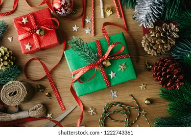 Merry christmas concepts with decorate gift box present and ornament element on wood table background.winter season's greetingactivity ideas.top view