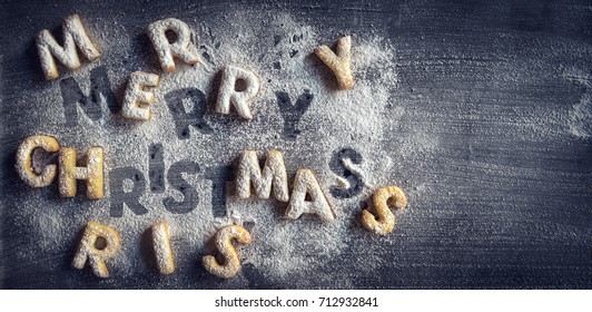 Merry Christmas cookies sign on dark background with blank space