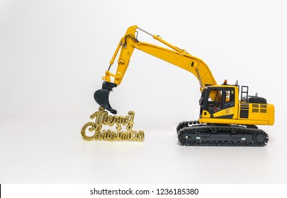 Merry Christmas  and Excavator model ,  Holiday celebration concept new year on white background