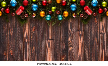 merry christmas frame with real wood green pine colorful baubles gift boxe and other
