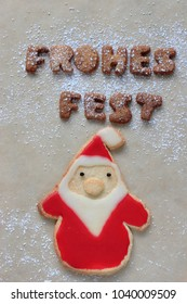 Merry Christmas (German - Frohes Fest)  and Santa Claus made of  cookies