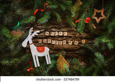 Merry Christmas. Christmas greeting card with rustic wood and ornaments. Xmas background.