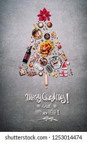 Merry Christmas greeting card with Christmas tree made with various Christmas foods for Christmas dinner