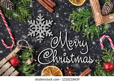 MERRY CHRISTMAS  handwritten inscription. Winter holiday composition. New Year and Christmas celebration. Winter holidays concept. Christmas decorations. Top View.